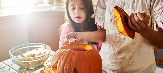 mother_and_daughter_having_fun_carving_pumpkin02.jpg